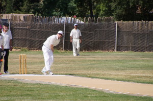 American Brett Weis bowls in the recent game against Marin CC as Amritpal Bhatal (blue hat) fields in the deep
