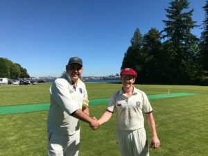 Meraloma CC captain Raj Sidhu (L) shakes hands with NVCC tour captain Leigh Ritchie after the toss at picturesque Stanley Park in Vancouver