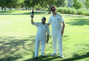NVCC Captain Rob Bolch (R) pictured presenting the Clos du Val Man of the Match award to Marin CC Socials Bilal for his not out innings in the recent game between the two teams
