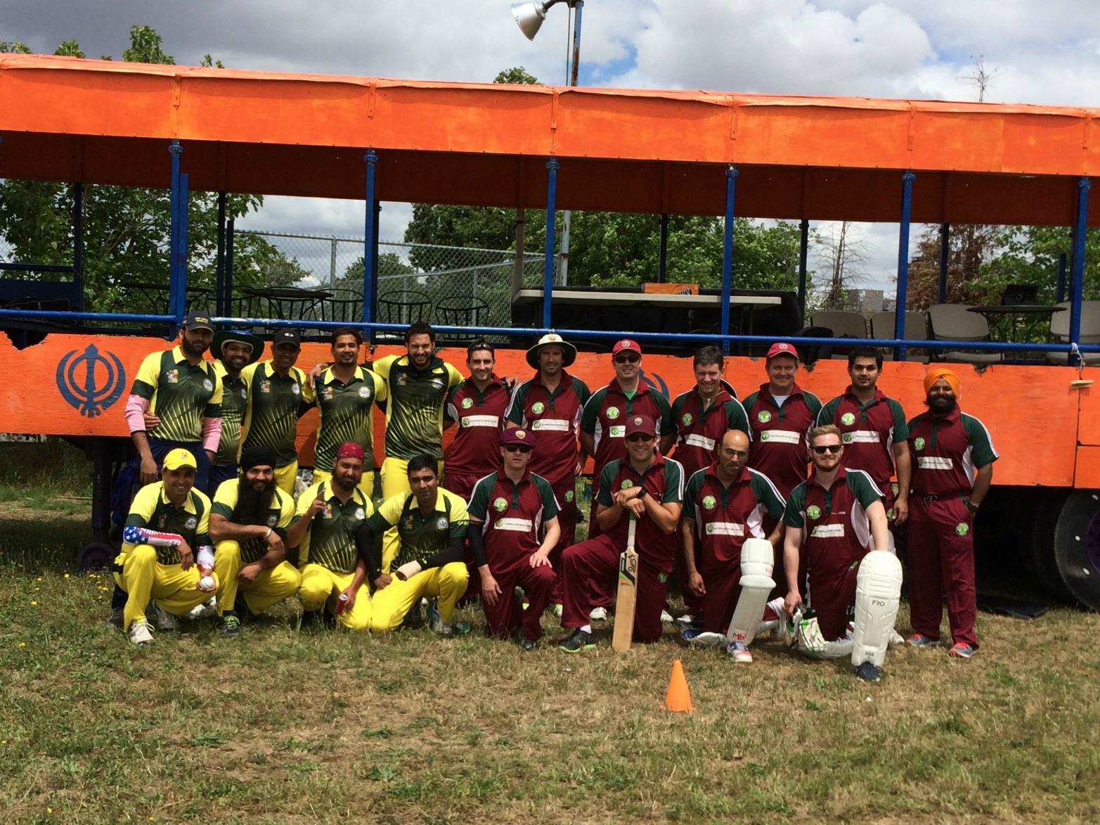 Team picture with Bradshaw CC left (yellow and green) and NVCC on right (maroon and green)