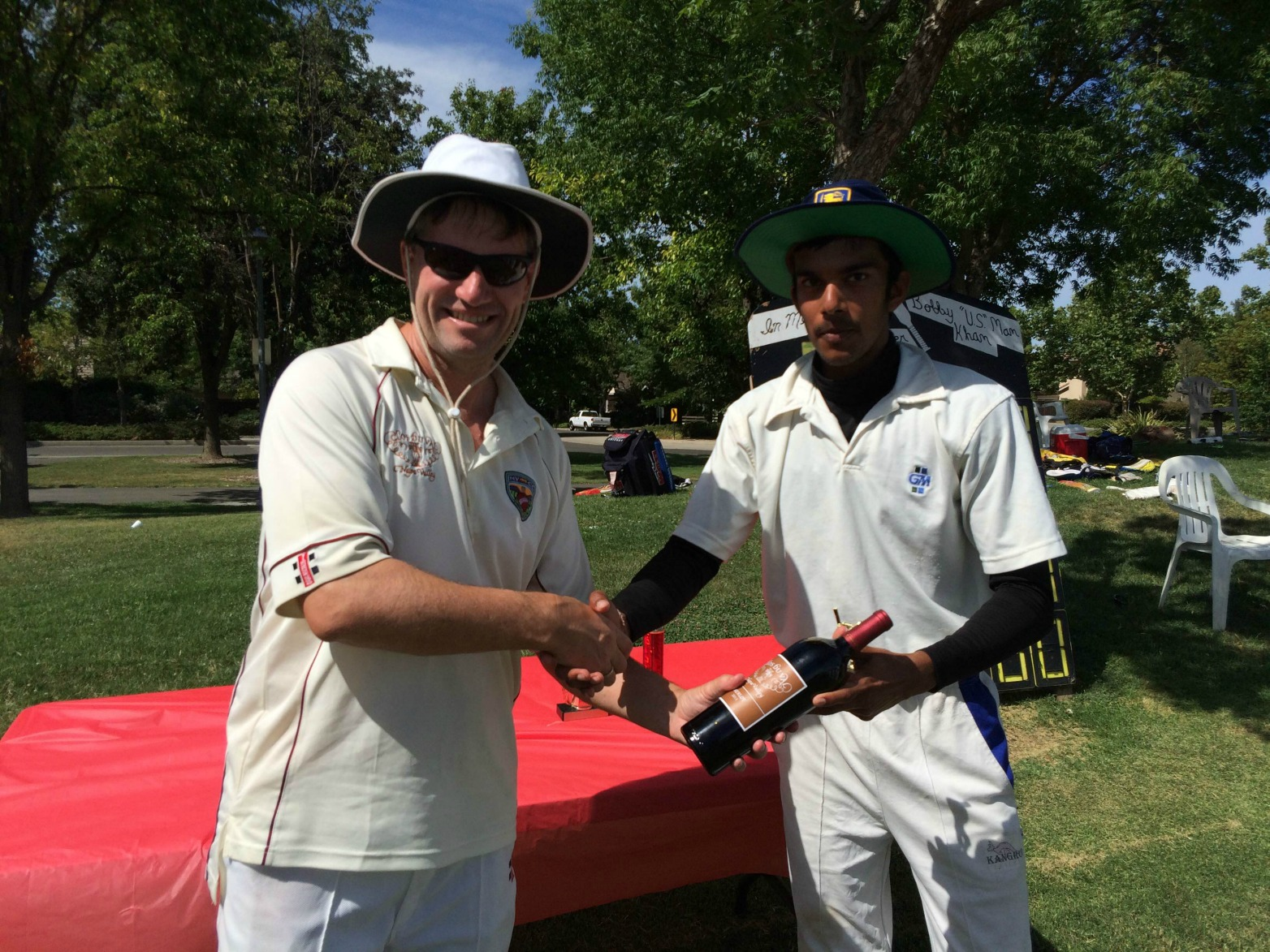 NVCC Captain Bernie Peacock presenting the Clos du Val Man of the Match award to SCC's Captain Kavindu Dhanapala. Submitted Photo