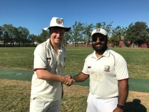 NVCC County captain Bernie Peacock (L) shakes hands with NVCC City captain Chandanpreet Singh at the toss for the inaugural NVCC City v County Challenge Match