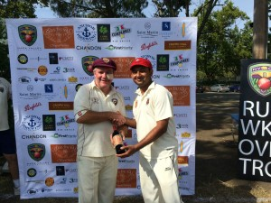 NVCC President Phil Bourke (L) present Twitter Kabootars batsman Kailash with the Clos du Val Man of the Match award