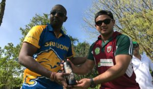 NVCC captain on the day Adersh Maqsood (R) presents Sri Lanka Lions players Savi with the Clos du Val Man of the Match Award. Su