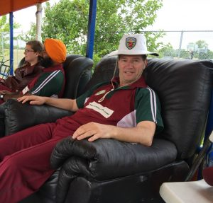 NVCC vice captain Bernie Peacock takes a well deserved rest after his haul of 3 wickets for 25 runs in 5.5 overs. Also pictured is NVCC member Chandanpreet Virk and his wife Michelle