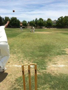 NVCC's Martin Mackenzie (with bat at far end) opening the batting for NVCC against SCC in Davis recently.