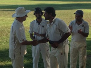 Napa Valley CC captain Rob Bolch (L) presents Kanishka Pothuka from Marin CC with the Clos du Val Man of the Match award