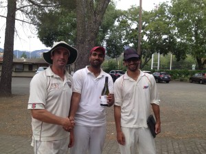Napa Valley CC club captain Martin Mackenzie (L) presents Harsh Gandhi from Marin CC with the Clos du Val Man of the Match award as Marin CC captain Raj Thiagaraj (R) looks on