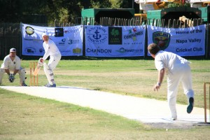 Pete Carson (R) bowls to Merion CC batsman as Pete Sander (L) keeps wicket