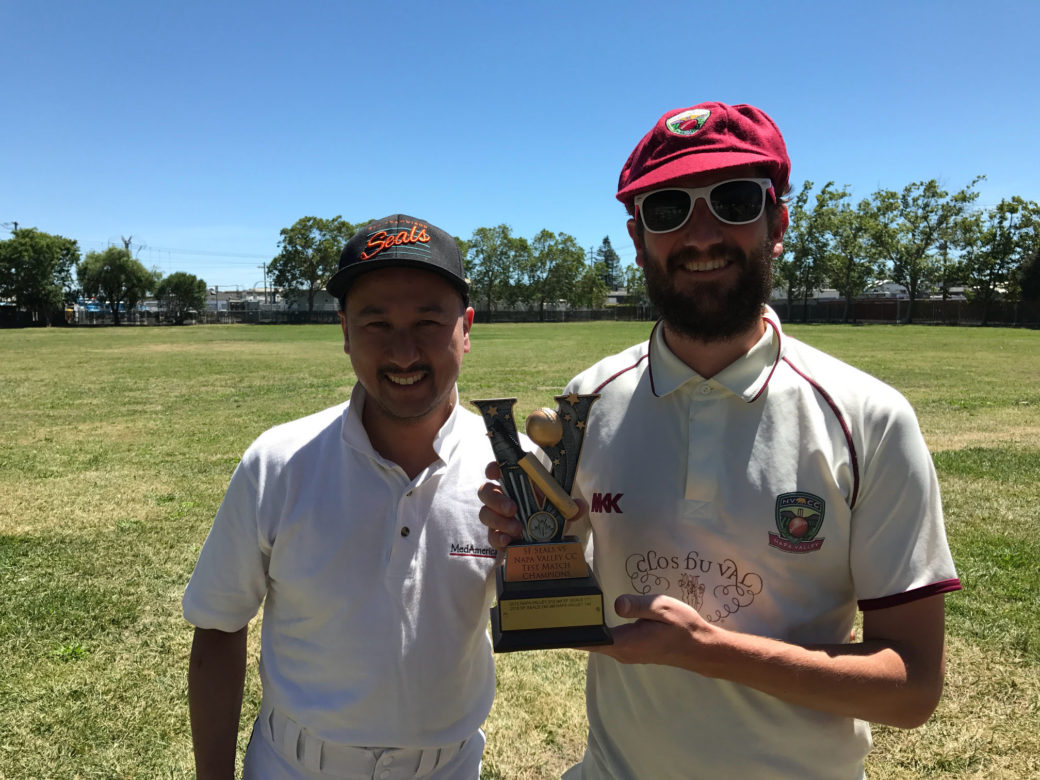 SF Seals captain Jack Tse (l) presents NVCC captain Brendan Helme with the Vino Cup following NVCC's win over the Seals recently, Submitted Photo