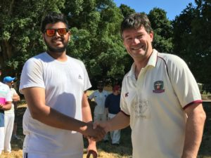 Sonoma Gullies Jay Patel (L) is congratulated by NVCC club captain Bernie Peacock after his receipt of the Clos du Val Man of the Match award.